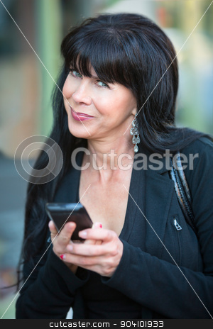 Attractive Woman with Mobile Phone stock photo, Business woman with long dark hair using smart phone by Scott Griessel