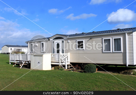 White caravans in a park stock photo, White caravans in a modern trailer park, Scarborough, England. by Martin Crowdy