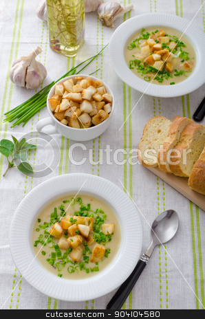 Garlic soup with croutons, spring onions and chives