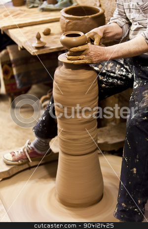 Turkish Potter in Cappadocia stock photo, Potters hands forming clay on wheel in Cappadocia Turkey by Scott Griessel