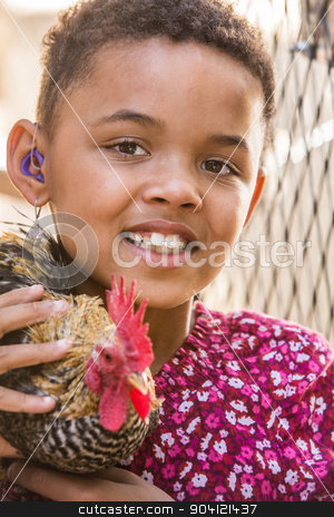 Girl With Rooster stock photo, Cute African girl with hearing aid holding a rooster by Scott Griessel