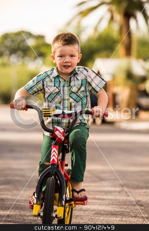 Boy On a Bike stock photo, Single young boy having fun riding his bike by Scott Griessel
