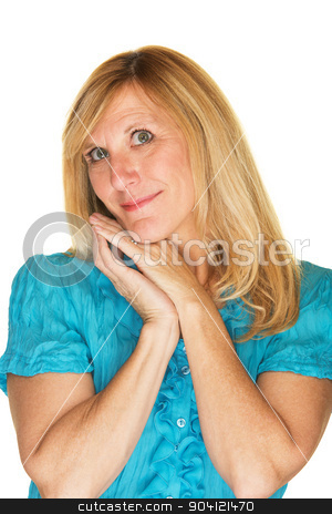 Hopeful Woman Leaning Over stock photo, Beautiful contented blond adult with hands on cheek by Scott Griessel