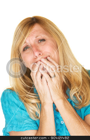 Emotional Woman stock photo, Emotional blond woman in blue with hands over mouth by Scott Griessel