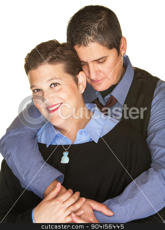 Contented Woman Held By Girlfriend stock photo, Smiling lesbian female held by partner from back by Scott Griessel