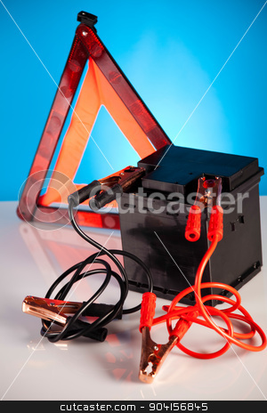 Car battery with two jumper cables clipped on vivid moto concept stock photo, Car battery with two jumper cables clipped on vivid moto concept by Sebastian Duda