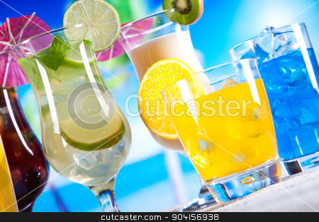 Alcohol drinks, beach background, natural colorful tone stock photo, Alcohol drinks, beach background, natural colorful tone by Sebastian Duda