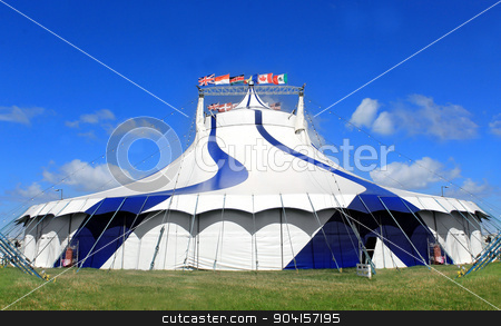 Circus tent in a field stock photo, Circus tent in a field on a summer day. by Martin Crowdy