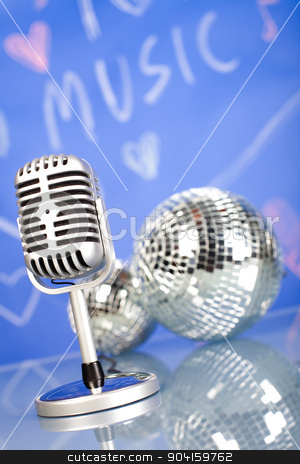 Microphone with disco balls, music saturated concept stock photo, Microphone with disco balls, music saturated concept by Sebastian Duda