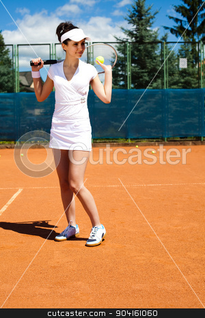 Woman playing tennis, summertime saturated theme stock photo, Woman playing tennis, summertime saturated theme by Sebastian Duda