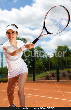Young woman tennis player on the court stock photo, Young woman tennis player on the court by Sebastian Duda