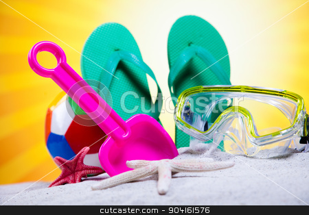 Colorful plastic toys on the beach stock photo, Colorful plastic toys on the beach by Sebastian Duda