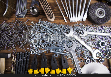Assorted work tools on wood background stock photo, Assorted work tools on wood background by Sebastian Duda