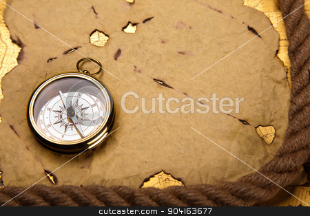 Compass on the old paper background stock photo, Compass on the old paper background by Sebastian Duda