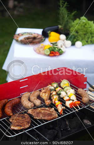 Grilling meat in flames, tasty dinner  stock photo, Grilling meat in flames, tasty dinner by Sebastian Duda