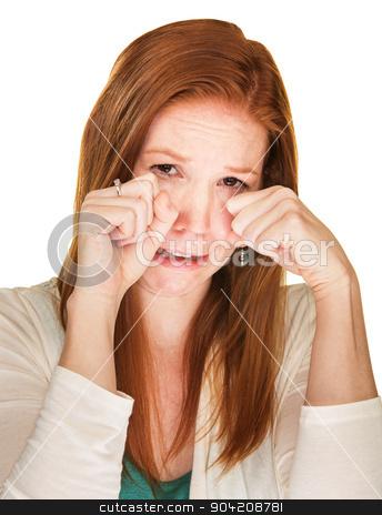 Sobbing Woman Rubbing Her Eyes stock photo, Isolated beautiful sobbing female rubbing her eyes by Scott Griessel