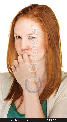 Scheming Female stock photo, Thinking red haired woman with a devious expression by Scott Griessel