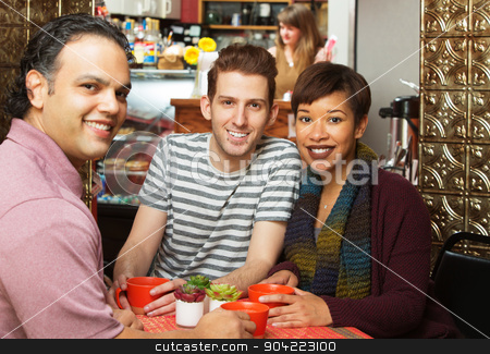 Three People in Cafe stock photo, Three young adults at coffee house indoors by Scott Griessel