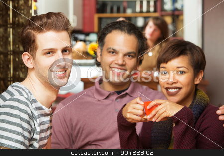 Handsome Trio in Bistro stock photo, Handsome trio of adults having coffee at bistro by Scott Griessel