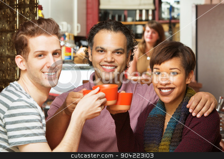 Group Toasting in Cafe stock photo, Group of three adults toasting coffee mugs in cafe by Scott Griessel