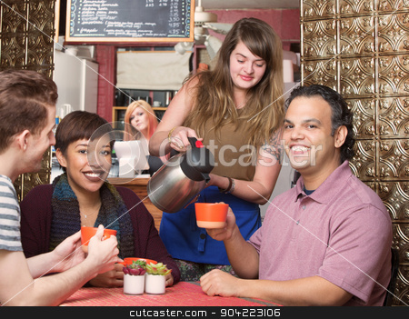 Waitress Pouring Coffee stock photo, Cute waitress pouring coffee for happy customers by Scott Griessel