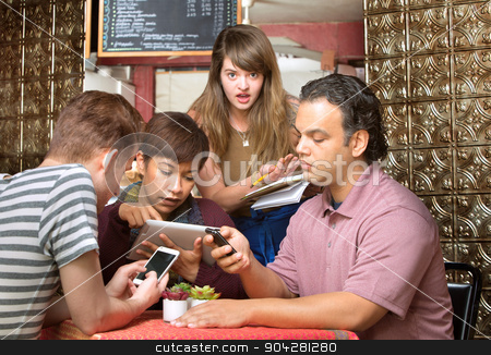 Diners Ignoring Waitress stock photo, Rude diners ignoring waitress in a coffee house by Scott Griessel