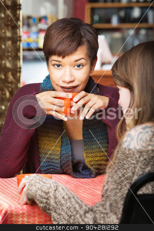 Easygoing Lady with Friend stock photo, Easygoing beautiful woman holding coffee mug at table by Scott Griessel
