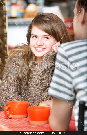 Flirting with Man stock photo, Happy woman staring at man in cafe by Scott Griessel