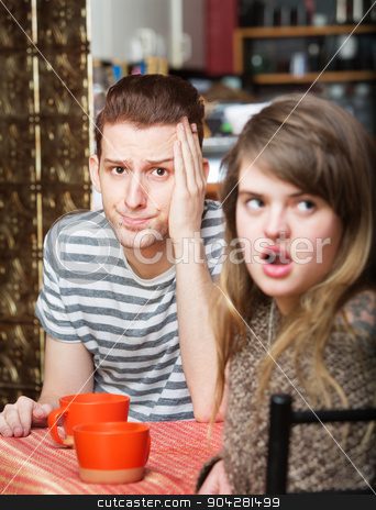 Irritated Woman with Man stock photo, Frustrated young man sitting in cafe with woman by Scott Griessel