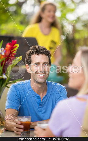 Handsome Man Outdoors stock photo, Handsome Caucasian man in blue shirt with date by Scott Griessel