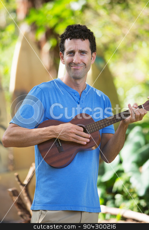 Ukelele Performer in Hawaii stock photo, Cute male playing ukelele outdoors in Hawaii by Scott Griessel
