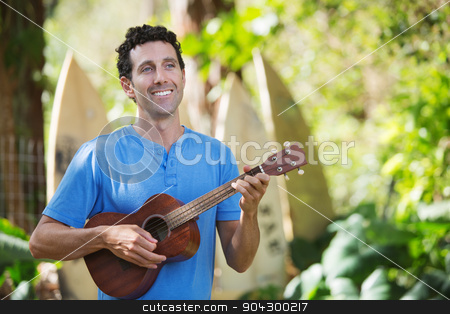 Handsome Ukelele Performer stock photo, Single handsome male in blue playing ukelele by Scott Griessel