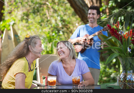 Mature Friends with Ukelele Player stock photo, Two mature happy women with ukelele player by Scott Griessel