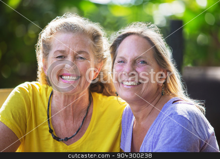 Close Up of Smiling Friends stock photo, Close up of smiling mature Caucasian female friends by Scott Griessel