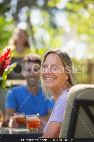 Cute Woman on Vacation stock photo, Attractive woman with friend on vacation at table by Scott Griessel
