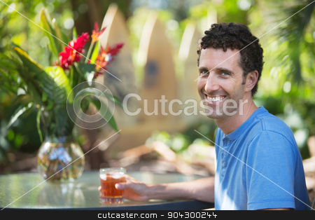 Happy Man in Maui with Drink stock photo, Attractive single adult male with drink in Maui Hawaii by Scott Griessel