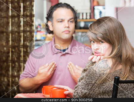 Annoyed Woman with Argumentative Man stock photo, Arguing man and woman in coffee house by Scott Griessel