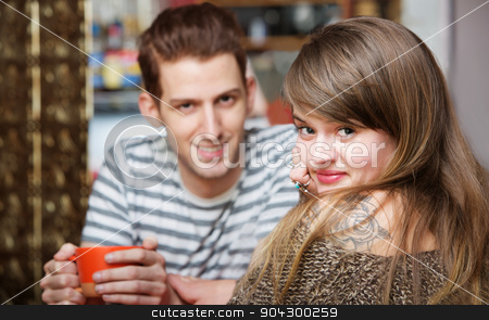 Handsome Man with Woman in Cafe stock photo, Handsome smiling man with cute woman in cafe by Scott Griessel