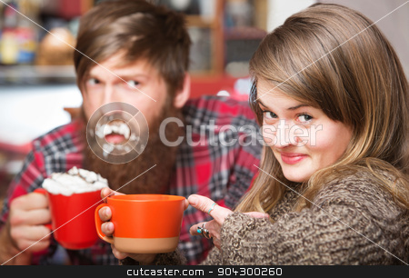 Smiling Woman with Sloppy Man stock photo, Grinning woman pointing to clueless man with cream on his beard by Scott Griessel