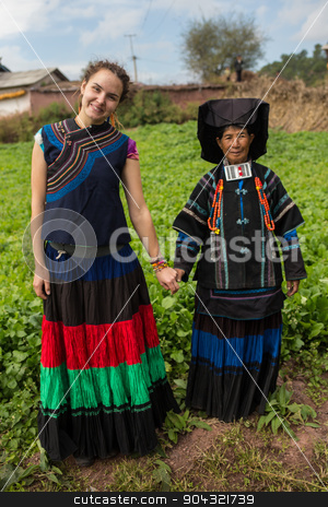 Woman in national costume with family