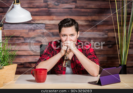 Tense Office Worker with Hands on Mouth stock photo, Tense office worker with hands over her mouth by Scott Griessel