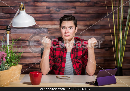 Outraged Woman with Clenched Fists stock photo, Frustrated woman in flannel shirt with clenched fists by Scott Griessel