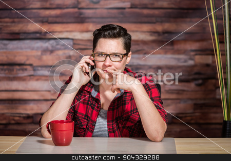 Thinking Office Worker on Phone stock photo, Thinking office worker with eyeglasses and phone by Scott Griessel