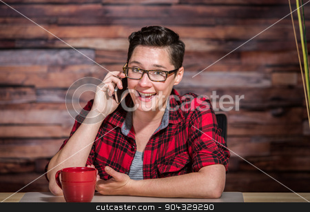 Enthusiastic Woman on Smart Phone stock photo, Enthusiastic woman in business casual outfit on phone by Scott Griessel