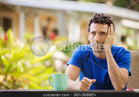 Bored Man on Vacation stock photo, Bored single Caucasian male on vacation by Scott Griessel