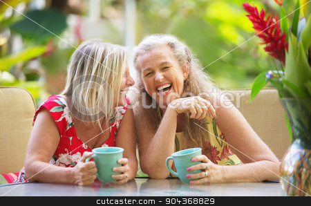 Girlfriends Laughing stock photo, Pair of cute middle aged female friends laughing by Scott Griessel