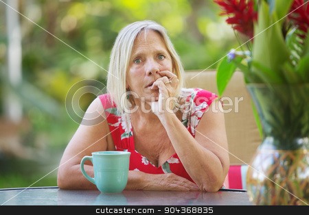 Nervous Woman Biting Fingernails stock photo, Serious Caucasian adult biting fingernails with worried expression  by Scott Griessel