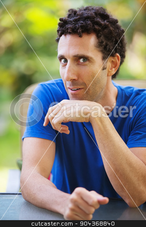 Eager Man Talking stock photo, Eager single Caucasian man at table talking by Scott Griessel