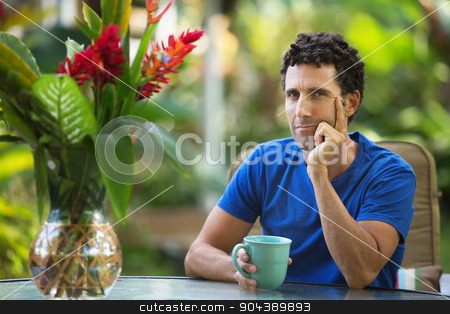 Serious Man with Hand on Chin stock photo, Serious male adult sitting outdoors with hand on chin by Scott Griessel