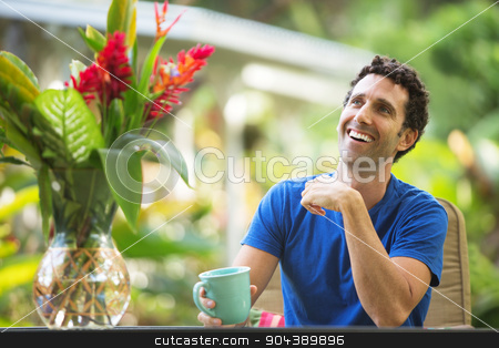 Man Laughing Outdoors stock photo, Single man with mug smiling looking up by Scott Griessel